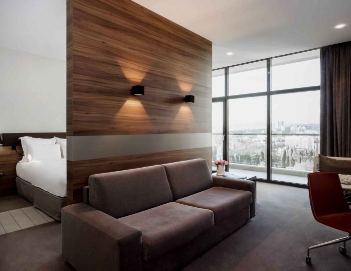Junior suite with double bed and sofa (city view) - Отель «Pullman Sochi Centre»